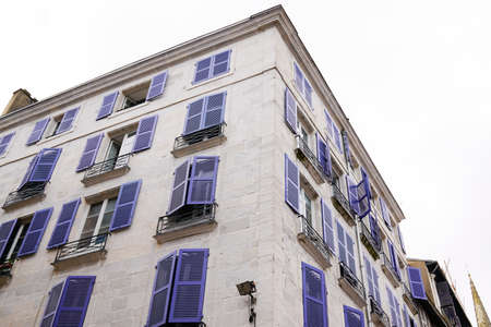 typical white and blue house Bayonne facades in the South West of France