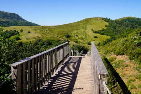wooden bridge access to the Puy de Dôme volcano mountain on Puy Pariou in Auvergne french Banco de Imagens