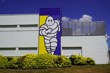 Clermont Ferrand, Auvergne / France - 09 23 2019: Michelin bibendum sign logo front of tires factory in Clermont Ferrand