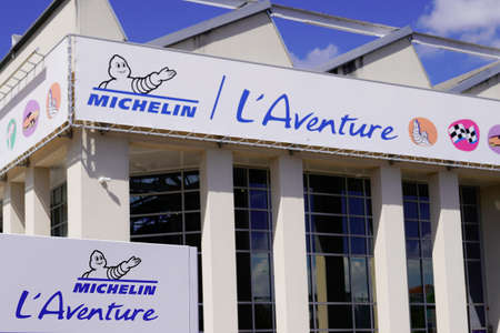 Clermont Ferrand, Auvergne / France - 09 23 2019: Michelin the adventure bibendum logo sign and text logo on corporate museum aside factory in Clermont Ferrand