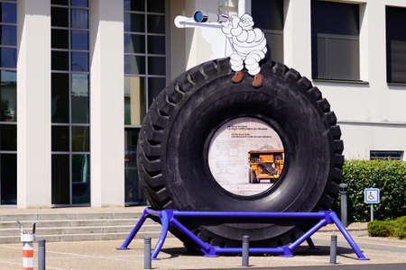 Clermont-Ferrand, auvergne / France - 08 10 2020: Michelin bibendum front of corporate museum with biggest tire in the world made in spain and usa