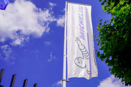 Clermont Ferrand, Auvergne / France - 09 23 2019: Michelin bibendum logo sign and text on white flag of tires store