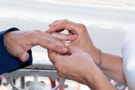 marriage exchange of wedding rings bride and groom during ceremony Stock Photo