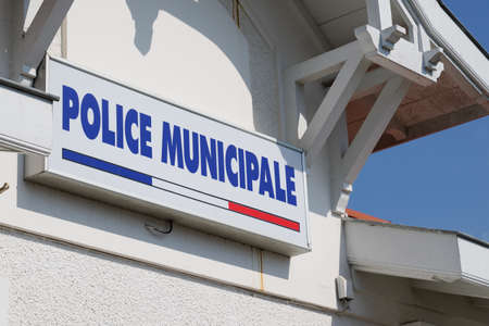 Municipal police logo and text sign on official building of mayor local police