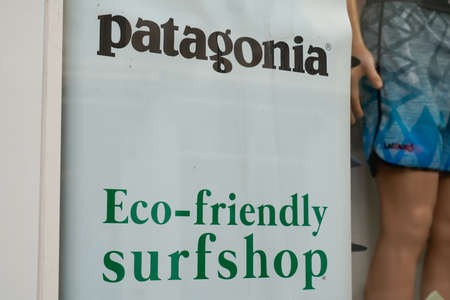 Bordeaux, Aquitaine / France - 09 01 2020: Patagonia store logo above the entrance to shop with text eco-friendly surfshop