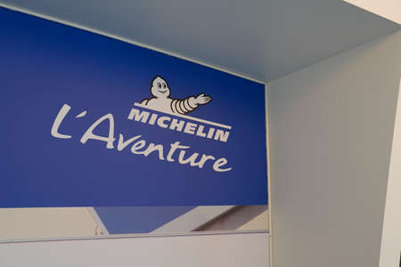 Clermont Ferrand, auvergne / France - 08 10 2020: Michelin l'Aventure bibendum logo blue sign and text front of entrance of corporate museum Redactioneel