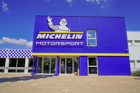 Clermont Ferrand, Auvergne / France - 09 23 2019: Michelin motorsport logo and text sign front of headquarter of tires manufacturer sport brand based in Clermont Ferrand France