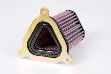 Car and motorcycle engine triangle air intake filter stage 2 on white background Foto de archivo