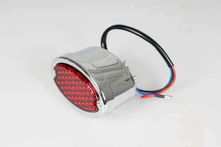motorcycle rear red brake light chrome of a classic motorbike vintage