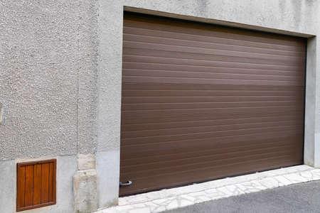 garage brown door of residential house Foto de archivo