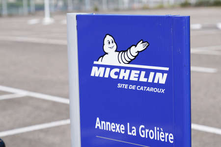Clermont-Ferrand,, Auvergne / France - 09 01 2020: Michelin bibendum logo sign and text front of Cataroux factory of tires Redactioneel