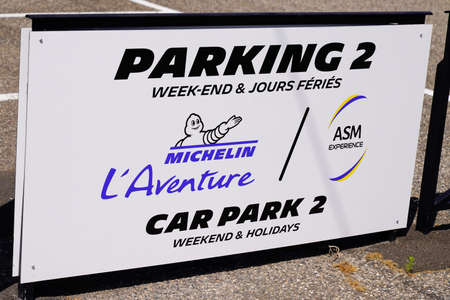 Clermont-Ferrand,, Auvergne / France - 09 01 2020: Michelin l'Aventure bibendum logo for car park sign and text front of entrance corporate tires industrial museum Redactioneel