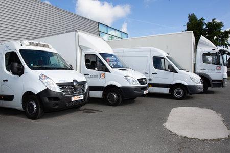 Bordeaux, Aquitaine / France - 09 25 2020: transport dumont several white cars vans trucks parked in parking lot for rental and delivery Redakční