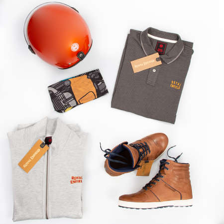 Bordeaux, Aquitaine / France - 10 10 2020: royal enfield accessories motorcycle flat lay of fashion biker helmet choker shoes and polo vest for rider