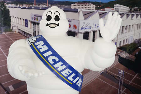 Clermont-Ferrand, Auvergne / France - 09 01 2020: michelin bibendum logo and text sign front of museum shop of tires