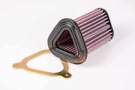 Car motorcycle engine air intake filter with steel stage 2 on isolated white background Foto de archivo