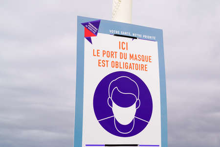 arcachon, Aquitaine / France - 16 10 2020: port du masque obligatory sign and text in Arcachon city French for wearing a face mask is mandatory