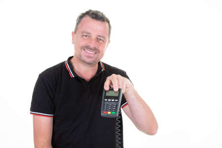 man in black polo holding bank terminal for credit card payment 免版税图像