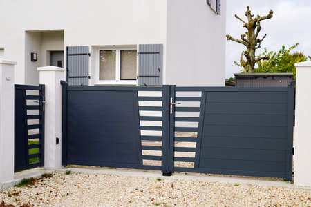 modern dark gray gate aluminum portal and door outdoor of suburbs house