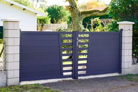 Aluminum modern style home gray gate portal of suburb door house Reklamní fotografie