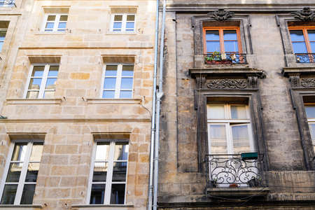 Before and After cleaning building stones facades with difference of wash clean house and dirty one Stock fotó
