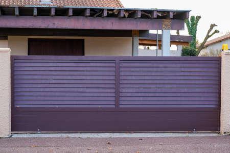 sliding portal street suburb home brown dark metal aluminum house gate garden access door