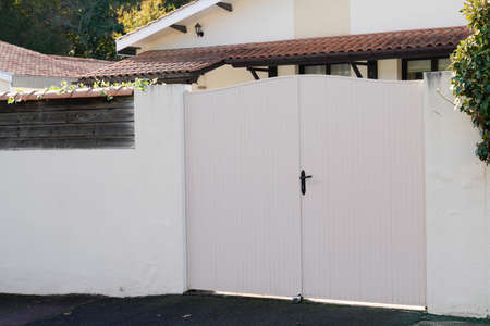 door steel big white metal gate fence on modern suburb house street portal