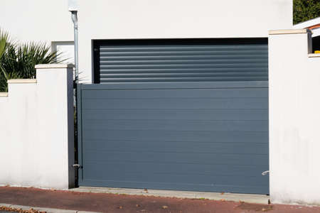 sliding portal large metal gate gray fence on suburb street house door