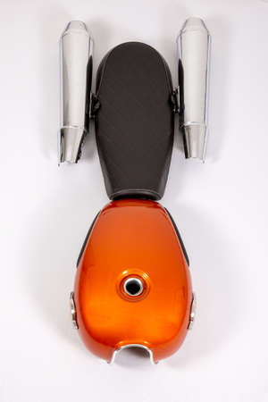motorcycle part tank seat and mufflers exhaust parts motorbike in flat lay top view