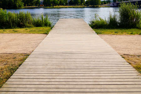 Wooden pontoon to access gingham Allier river coast in Vichy city France Stockfoto