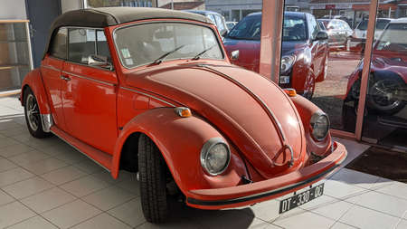 Bordeaux, Aquitaine France - 01 05 2021: vw Volkswagen Beetle convertible red old vintage car parked on shop