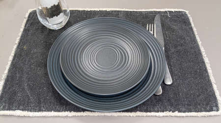 gray ceramic plate on table gray background Stockfoto