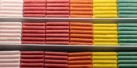 Multicolored towels counter in the store with a stack towel bath