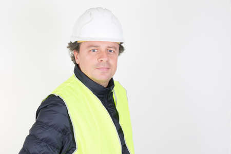 handsome man in white background with helmet hard hat in Engineering concept construction site