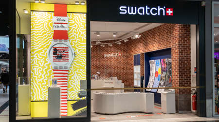 Bordeaux, Aquitaine France - 01 10 2021: Swatch watches shop facade colorful store sign and watch logo for watchmaker boutique with disney brand Redactioneel