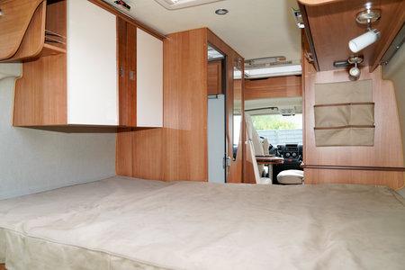 wooden interior large bedroom of Camper van ready for vanlife holidays