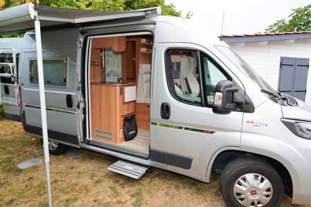 Bordeaux, Aquitaine France - 01 18 2021: Fiat ducato RV holiday gray motor home with open awning campervan