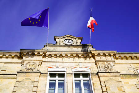 French and eu europa flag on town hall building mean city hall in town in france