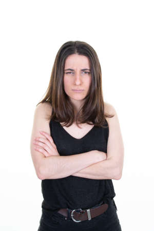 Portrait of sad angry woman standing with arms crossed on white background