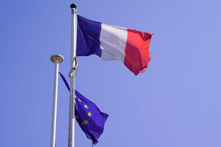 flying red blue white French and european eu flag on summer sky