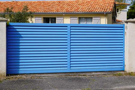 Blue classic portal sliding modern house gate door to access garage home garden