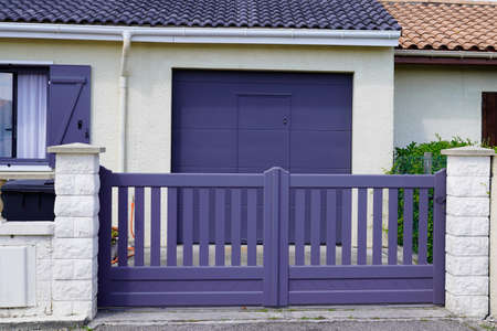 Aluminum modern home gray steel gate portal of suburb house in street view Archivio Fotografico