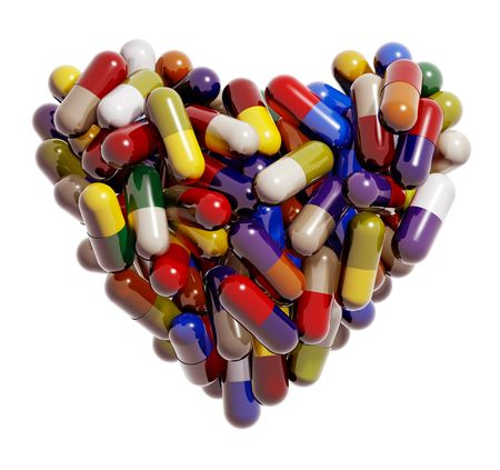 Heart created of colorful medical pills photo