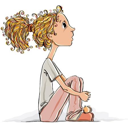 Cute little girl sitting on a floor.