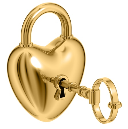 Lock formed as heart with a golden key. photo