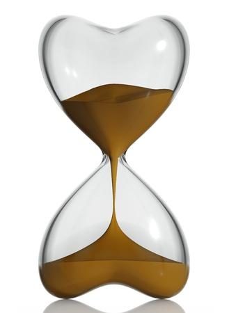 Песок часы в форме сердца. Фото со стока