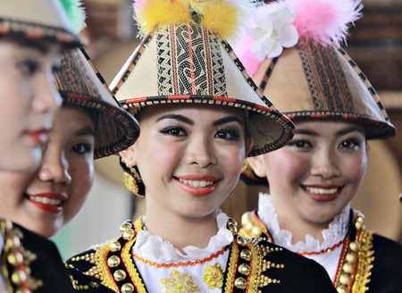 sabah: Kota Kinabalu Malaysia  May 30 2015: Kadazan Papar ladies in their traditional costume pose for the camera during the Sabah State Harvest festival celeberation in Kota Kinabalu Sabah Malaysia. Editorial