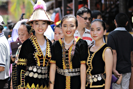 sabah: Kota Kinabalu Malaysia  May 30 2015: Ladies from various ethnic of native Sabah in their traditional costume pose for the camera during the Sabah State Harvest festival celeberation in Kota Kinabalu Sabah Malaysia.