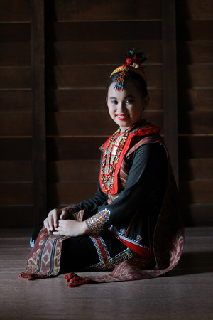 sabah: Kota Kinabalu Malaysia  May 30 2015: A Dusun Lotud lady pose for guests during the State Harvest Festival Celeberation in Kota Kinabalu Sabah.