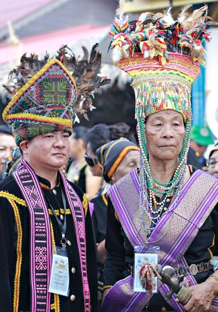 kota kinabalu: Kota Kinabalu Malaysia  May 30 2015:Two high priests of the Kadazan ethnic or locally known as Bobohizan waiting for the VIPs during the State Harvest Festival Celeberation in Kota Kinabalu Sabah Malaysia.
